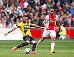 Nederland, Amsterdam, 19 april 2015<br /> Eredivisie<br /> Seizoen 2014-2015<br /> Ajax-NAC Breda (0-0)<br /> Adnane Tighadouini van NAC Breda en Ricardo van Rhijn van Ajax strijden om de bal