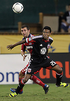 WASHINGTON, DC. - AUGUST 22, 2012:  Lionard Pajoy (26) of DC United keeps the ball away from  Gonzalo Segares (13) of the Chicago Fire during an MLS match at RFK Stadium, in Washington DC,  on August 22. United won 4-2.