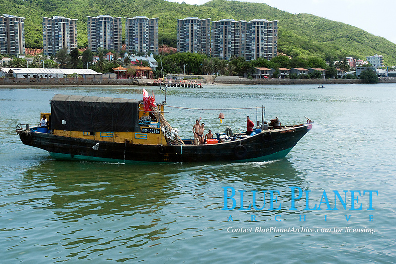 Fishing men waving from their fishing boat, Sanya, Hainan, China, South China Sea, Pacific Ocean