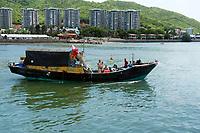 Fishing men waving from their fishing boat, Sanya, Hainan, China, South China Sea, Pacific Ocean