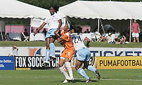 Sky Blue forward Natasha Kai is flanked by Red Stars defenders Ifeoma Dieke and Jill Oakes. Sky Blue defeated the Chicago Red Stars 1-0 on Sunday, July 19, 2009.