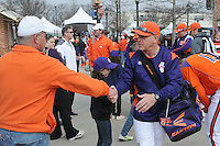 Clemson head coach Jack Leggett is greeted by fans in the first ever Tiger Walk as the team heads into the Reedy River Rivalry game against the Clemson Tigers on March 1, 2014, at Fluor Field at the West End in Greenville, South Carolina. South Carolina won, 10-2. (Tom Priddy/Four Seam Images)