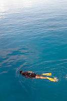 A woman snorkelling in the Caribbean Sea at Cozumel, Mexico