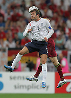 English midfielder (7) David Beckham goes up for a header.  Portugal defeated England on penalty kicks after playing to a 0-0 tie in regulation in their FIFA World Cup quarterfinal match in Gelsenkirchen, Germany, July 1, 2006.