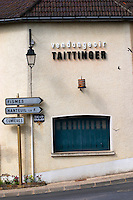 A street with street signs to Fismes, nanteuil and Cumieres and a building that is the vendangeoir Taittinger (wine press house in the vineyard), the village of Hautvillers in Vallee de la Marne, Champagne, Marne, Ardennes, France