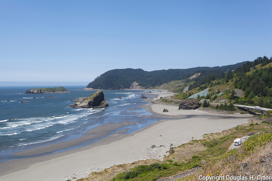 U.S. HIghway 101, also known as Route 101 or the Oregon Coast Highway skkrts Hunters Cove with views to Cape Sebation in the north. and the Pistol River entering the Pacific Ocean.