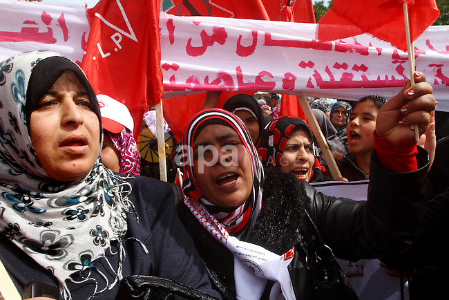 Supporters of the Democratic Front for the Liberation of Palestine (DFLP) shout slogans during a rally marking the 43rd anniversary of the movement's establishment in Gaza City on February 23, 2012. Photo by Ashraf Amra