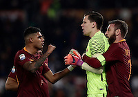Calcio, Serie A: Roma vs Milan. Roma, stadio Olimpico, 12 dicembre 2016.<br /> Roma's goalkeeper Wojciech Szczesny, center, is hugged by teammates Emerson Palmieri, left, and Daniele De Rossi after saving a penalty kicked by Milan's M'Baye Niang, not seen, during the Italian Serie A football match between Roma and AC Milan at Rome's Olympic stadium, 12 December 2016.<br /> UPDATE IMAGES PRESS/Isabella Bonotto