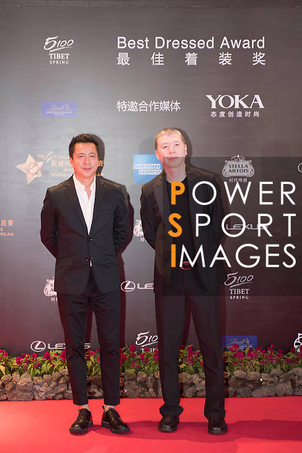 Feng Xiaogang (right) during the Red Carpet event at the World Celebrity Pro-Am 2016 Mission Hills China Golf Tournament on 20 October 2016, in Haikou, China. Photo by Weixiang Lim / Power Sport Images