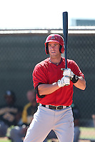 Cal Towey #45 of the Los Angeles Angels bats during a Minor League Spring Training Game against the Oakland Athletics at the Los Angeles Angels Spring Training Complex on March 17, 2014 in Tempe, Arizona. (Larry Goren/Four Seam Images)