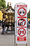 Organizers put notices in various places to prohibit drones, music and alcohol during the annual ''Mitama Festival'' at Yasukuni Shrine on July, 13, 2015, Tokyo, Japan. Over 30,000 lanterns line the entrance to the shrine to help spirits find their way during the annual celebration for the spirits of ancestors. The festival is held from July 13th to 16th. (Photo by Rodrigo Reyes Marin/AFLO)