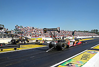 Mar. 16, 2013; Gainesville, FL, USA; NHRA top fuel dragster driver David Grubnic (right) races alongside Tony Schumacher during qualifying for the Gatornationals at Auto-Plus Raceway at Gainesville. Mandatory Credit: Mark J. Rebilas-