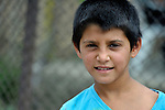 A boy in a largely Roma, Turkish-speaking neighborhood of Dobrich, in the northeast of Bulgaria.