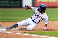 Tennessee Smokies left fielder Christian Donahue (3) slides into third base against the Montgomery Biscuits on May 9, 2021, at Smokies Stadium in Kodak, Tennessee. (Danny Parker/Four Seam Images)