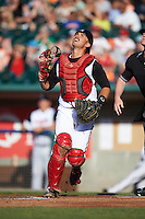 Lansing Lugnuts catcher Mike Reeves (25) tracks a pop up foul ball during a game against the Peoria Chiefs on June 6, 2015 at Cooley Law School Stadium in Lansing, Michigan.  Lansing defeated Peoria 6-2.  (Mike Janes/Four Seam Images)