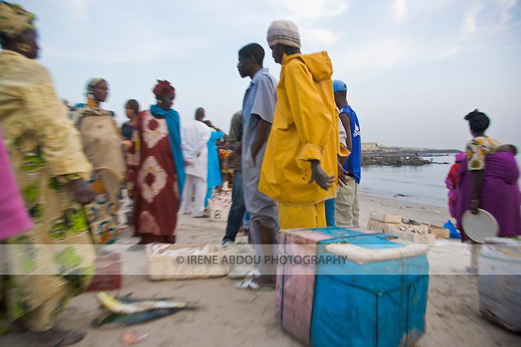 Potential customers bargain for a good price at this beachside fish market in Dakar, Senegal.