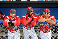Batavia Muckdogs catcher Felix Castillo (30), shortstop Javier Lopez (35), and infielder Luis Ortiz (26) before a game against the Auburn Doubledays on July 3, 2013 at Dwyer Stadium in Batavia, New York.  Batavia defeated Auburn 12-2.  (Mike Janes/Four Seam Images)