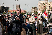 Journalist Marie Colvin photographed in Tahrir square, the scene of heavy clashes between pro and anti government protesters. Continued anti-government protests take place in Cairo calling for President Mubarak to stand down. After dissolving the government and allowing for talks with opposition parties Mubarak still refuses to step down from power.