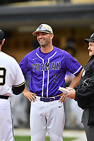 Head coach Brett Harker (31) of the Furman Paladins meets with the umpires before a game against the Wofford Terriers on Friday, March 24, 2017, at Russell C. King Field in Spartanburg, South Carolina. Wofford won, 9-8. (Tom Priddy/Four Seam Images)