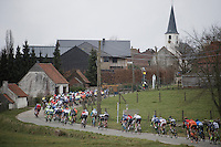 peloton cruising through Flanders villages and clocking just inside the 50km/h speed limit<br /> <br /> 71st Dwars door Vlaanderen (1.HC)