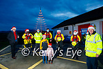 Banna Rescue light their Christmas tree in Banna on Sunday. Front: Pat Lawlor. Back l to r: Eoin Buckley, Thomas, Amy and Ava Fitzgerald, Dáire McGovern, John Sheehan and Grainne Costello.