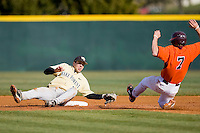 Mark Rhine #2 of the Wake Forest Demon Deacons makes an acrobatic tag on Buddy Sosnoskie #7 of the Virginia Tech Hokies as he tries to steal second base at English Field March 27, 2010, in Blacksburg, Virginia.  Photo by Brian Westerholt / Four Seam Images