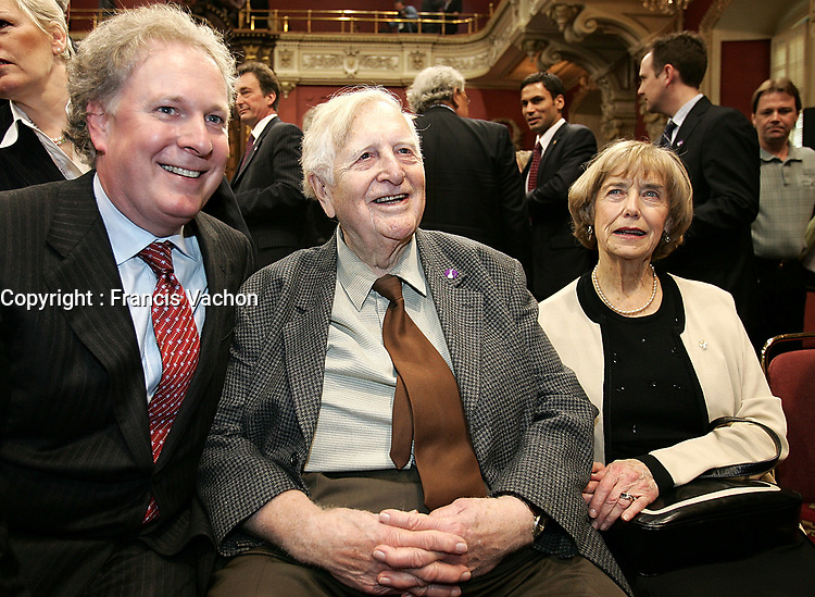 Quebec City, April 18, 2007 - Prime Minister Jean Charest poses with his father Claude Charest and friend Claire Kelly after the ceremony to sworn in the new Liberal cabinet at the National assembly in Quebec City April 18, 2007. The cabinet is one of the smallest of the recent years and includes an equal number of men and women.<br /> <br /> PHOTO :  Francis Vachon - Agence Quebec Presse