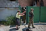 UKRAINE:  Ania, a former Inhabitant near the frontline of Sherokyne is complaining about her situation to a fighter of the Donbass battalion who came to her place in order to check the damages of the shelling last night. <br /> <br /> <br /> UKRAINE: Ania, une ancienne habitante près de la ligne de front de Shyrokyne se plaint de sa situation à un combattant du bataillon Donbass qui est venu constater les dégats des bombardement de la nuit dernière.