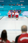 Sochi, RUSSIA - Mar 8 2014 -  Ina Forrest and Jim Armstrong watch as Russia takes a shot as Canada takes on Russia in Wheelchair Curling during the 2014 Paralympic Winter Games in Sochi, Russia.  (Photo: Matthew Murnaghan/Canadian Paralympic Committee)