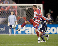 FC Dallas forward Kenny Cooper (33) receives pass as New England Revolution midfielder Steve Ralston (14) defends. The New England Revolution defeated FC Dallas, 2-1, at Gillette Stadium on April 4, 2009. Photo by Andrew Katsampes /isiphotos.com
