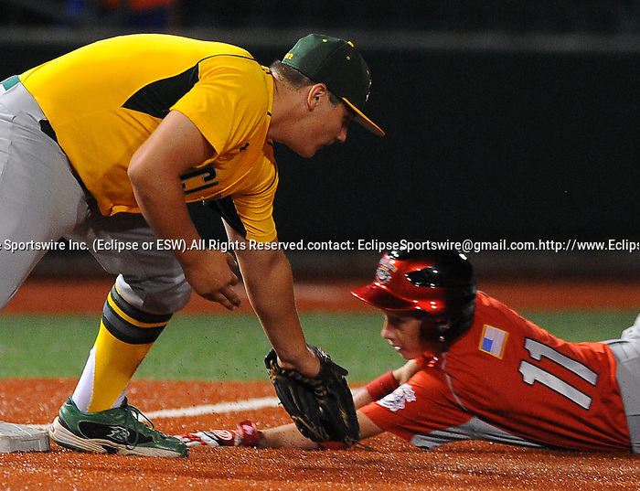 Longview(WA)'s Brett Coons tags out Mattoon(IL)'s Davis Johnson during the All Star Game at the Cal Ripken Babe Ruth World Series in Aberdeen, Maryland on August 16, 2012 featuring Team Bambino and Team Ironman comprised of players from all the teams that did not advance to the playoffs. Team Ironman (Longview(WA), Newtown(CT), Little Rock(AR) and Canada) defeated Team Bambino (Mattoon(IL), Lamar(CO), Harford County and Australia) 4 to 3.
