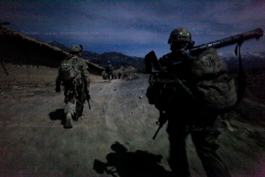 Members of1st Platoon, Chosen Company, 3-509 Infantry Airborne and Afghan Uniformed Police do a night patrol on one of the main suspected smuggling routes in northern Paktiya province. On December of 2011 members of 1st Platoon, Chosen Company, 3-509 Infantry Airborne out of Fort Richardson Alaska took over combat outpost Herrera in the Paktiya province of eastern Afghanistan. This combat outpost lies in the Jaji district of Paktiya and is expected to be one of the most volatile areas of 2012 (due to its mountainous terrain and proximity to Pakistan's lawless North Waziristan, the independent tribal area where most of the Haqqani Taliban network is suspected to be based out of). Several smuggling routes run through these mountains passes and are used by insurgents to transport weapons and explosives materials which are then used to launch attacks on ISF/ANSF and Kabul itself. ©Javier Manzano