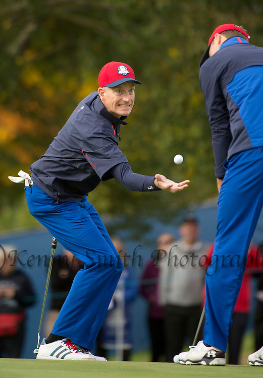 American Jim Furyk reacts as he catches his ball thrown by his Caddy which almost hits Jordan Speith on the head during a practice session at Gleneagles Golf Course, Perthshire. Photo credit should read: Kenny Smith/Press Association Images.