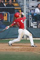 April 22, 2010: Newport High School shortstop Trace Tam Sing belts a game-winning home run against Redmond High School at Hartman Park in Redmond, Washington.