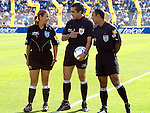 Referees Marco Antonio Rodriguez (C) talks with his comrades Isabel Tovar, one of the first women soccer referees, and  Jose Luis Camargo prior to the soccer match between Cruz Azul and America Aguilas at the Azul Stadium in Mexico City, April 15, 2006. America won 3-1 to Cruz Azul. Photo by © Javier Rodriguez