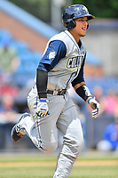 Columbia Fireflies Juan Uriarte (17) runs to first base during a game against the Asheville Tourists at McCormick Field on June 23, 2019 in Asheville, North Carolina. The Fireflies defeated the Tourists 11-9. (Tony Farlow/Four Seam Images)