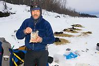 Robert Sorlie on Yukon River Eating a Snack Eagle Is Chkpt 2005 Iditarod