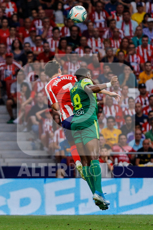 Joao Felix of Atletico de Madrid and Pape Diop of SD Eibar in action during La Liga match between Atletico de Madrid and SD Eibar at Wanda Metropolitano Stadium in Madrid, Spain.September 01, 2019. (ALTERPHOTOS/A. Perez Meca)