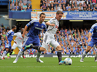 Pictured: Joe Allen of Swansea (R) marked by John Terry of Chelsea (L). Saturday 17 September 2011<br /> Re: Premiership football Chelsea FC v Swansea City FC at the Stamford Bridge Stadium, London.
