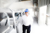 Chief Operating Officer of Vedanta Aluminum Ltd, Dr. Mukesh Kumar poses for a portrait next to processed alumina at the Vedanta factory in Lanjigarh, Orissa, India. Photo: Sanjit Das for Businessweek