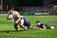 20120803 Copyright onEdition 2012©.Free for editorial use image, please credit: onEdition..Gerard Ellis of London Irish scores a try against Bath Rugby 7s at The Recreation Ground, Bath in the Final round of The J.P. Morgan Asset Management Premiership Rugby 7s Series...The J.P. Morgan Asset Management Premiership Rugby 7s Series kicked off again for the third season on Friday 13th July at The Stoop, Twickenham with Pool B being played at Edgeley Park, Stockport on Friday, 20th July, Pool C at Kingsholm Gloucester on Thursday, 26th July and the Final being played at The Recreation Ground, Bath on Friday 3rd August. The innovative tournament, which involves all 12 Premiership Rugby clubs, offers a fantastic platform for some of the country's finest young athletes to be exposed to the excitement, pressures and skills required to compete at an elite level...The 12 Premiership Rugby clubs are divided into three groups for the tournament, with the winner and runner up of each regional event going through to the Final. There are six games each evening, with each match consisting of two 7 minute halves with a 2 minute break at half time...For additional images please go to: http://www.w-w-i.com/jp_morgan_premiership_sevens/..For press contacts contact: Beth Begg at brandRapport on D: +44 (0)20 7932 5813 M: +44 (0)7900 88231 E: BBegg@brand-rapport.com..If you require a higher resolution image or you have any other onEdition photographic enquiries, please contact onEdition on 0845 900 2 900 or email info@onEdition.com.This image is copyright the onEdition 2012©..This image has been supplied by onEdition and must be credited onEdition. The author is asserting his full Moral rights in relation to the publication of this image. Rights for onward transmission of any image or file is not granted or implied. Changing or deleting Copyright information is illegal as specified in the Copyright, Design and Patents Act 1988. If you are in any way unsure of your right to publish this im