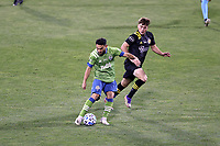 COLUMBUS, OH - DECEMBER 12: Cristian Roldan #7 of the Seattle Sounders FC is chased by Aidan Morris #21 of the Columbus Crew during a game between Seattle Sounders FC and Columbus Crew at MAPFRE Stadium on December 12, 2020 in Columbus, Ohio.