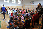 "Young children enter the gymnasium for a performance by Roma or gypsy theater Romathan in ""Dwarf"" at the Banske Elementary School with a Roma or gypsy majority student body in Banske, Slovakia on June 2, 2010."