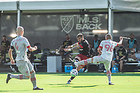 LAKE BUENA VISTA, FL - JULY 13: Ulises Segura #8 of DC United kicks the ball during a game between D.C. United and Toronto FC at Wide World of Sports on July 13, 2020 in Lake Buena Vista, Florida.