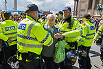 © Joel Goodman - 07973 332324 - all rights reserved . 03/06/2017 . Liverpool , UK . An elderly anti fascist is pulled from the front of the crowd by police as anti-fascists attempt to block the EDL march . Hundreds of police manage a demonstration by the far-right street protest movement , the English Defence League ( EDL ) and an demonstration by opposing anti-fascists , including Unite Against Fascism ( UAF ) . Photo credit : Joel Goodman