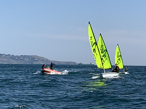 Colourful RS dinghies from Dun Laoghaire Harbour out for a sail in perfect sailing conditions on Dublin Bay