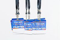 Trump 2020 campaign volunteer badges hang from lanyards on a wall during a Trump campaign office opening party in Salem, New Hampshire, on Fri., Sept. 18, 2020. Former 2016 Trump campaign manager and current 2020 Trump campaign senior advisor Corey Lewandowski, lives in nearby Windham, NH, spoke at the event, which also doubled as a surprise birthday celebration for Lewandowski.