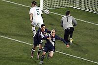 Michael Bradley (R) of USA celebrates scoring the equalising goal to make the score 2-2 against Slovenia with Herculez Gomez (L)