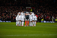 Saturday 11 January 2014 Pictured: wansea City pre match huddle<br /> Re: Barclays Premier League Manchester Utd v Swansea City FC  at Old Trafford, Manchester