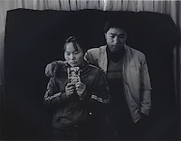 "Mr and Mrs Ma holds a picture of her son Ma Purei, 3 and half years old,  who was stolen  March 22nd  2004.  The message reads, ""Papa and Mama are hoping that you will come home soon.""  Mrs Ha and Mrs Ma is one of thousands of migrant mothers whose children have been stolen and sold to rich families desperate for a boy. Families are limited to a single child under the China's ruthless One Child Policy."